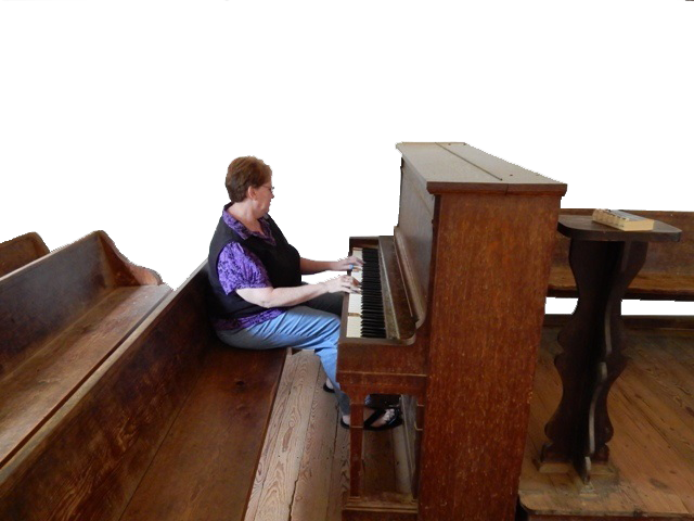 Reta playing the piano